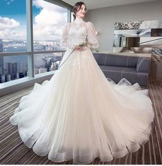 Vintage Long Sleeve Wedding Dresses 2018 High Neck Lace Appliques Open Back Wedding Gown Item specifics Sleeve Length(cm): Full Wedding Dress Fabric: Tulle Neckline: Scalloped Train: Cathedral/ Royal Train Dresses Length: Floor-Length Back Design: Lace Up Actual Images: Yes Silhouette: Ball Gown Decoration: Appliques,L