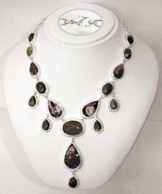 a stunning high-end silver necklace with 167.86 carat genuine gemstones