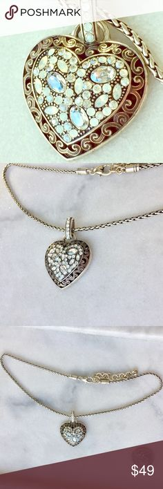 """🖤Brighton Iridescent Silver Heart Necklace🖤 Literally breathtaking. This necklace is in like new condition. The gems create an iridescent colorful reflection when they hit light. The back of the pendant as """"All you need is love"""" etched on back. COULD this be cuter?!?! Cleaned ultrasonically just for you ✨ Brighton Jewelry Necklaces"""