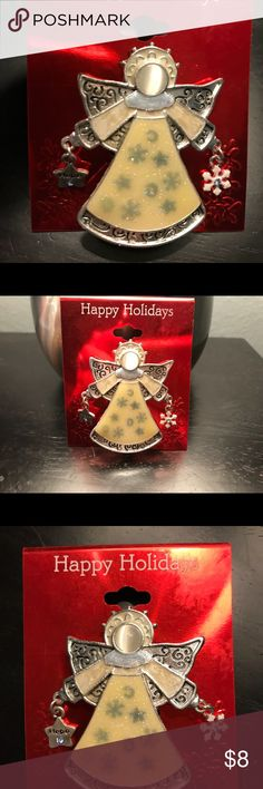 NWT HOLIDAY ANGEL PIN ❄️⭐️👼🏻 This Angel pin has one dangling snowflake and one star that says HOPE . Her dress has a cream color with the stars and snowflakes showing through. ⭐️👼🏻❄️ Table and Tower Jewelry Brooches