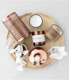 Style a glam bedside table with a collection of scented candles and copper candle holders.