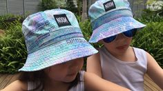 Cute Static print bucket hats! Noon Shadow's swim hat comes with an adjustable elastic toggle so it fits comfortably but stays put in the surf. They come in two sizes one for babies and one for bigger kids.
