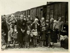 """Women and children on the Birkenau arrival platform known as the """"ramp"""". The Jews were removed from the deportation trains onto the ramp where they faced a selection process - some were sent immediately to their deaths, while others were sent to slave labor."""