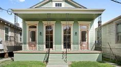 This Ward Victorian double shotgun was completely gutted and then renovated, according to the listing. The revived space now includes hardwood floors, custom lathe cabinetry, new kitchen. New Orleans Apartment, New Orleans Homes, Southern Homes, Coastal Homes, Shotgun House Interior, New Orleans Architecture, Creole Cottage, Beach Bungalows, My Dream Home