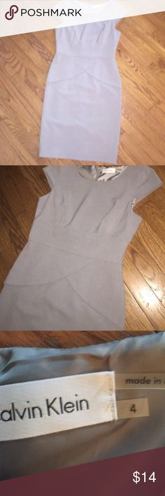 "NWOT CALVIN KLEIN dress Super sharp gray dress. Is lined and has slit in back. Great design. Was too big for me. Hit above knee. I'm 5'5"" Calvin Klein Dresses Mini"