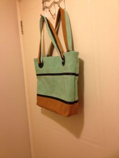 Fully lined and zippered tote bag made from Nigerian Aso-Oke with bias strips and curtain eyelets for handles
