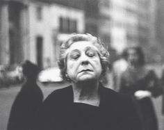 Diane Arbus - woman on the street with her eyes closed 1956