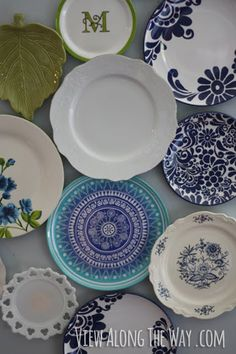 Plates on a wall, hung in a fresh, organic way, wrapping around a corner