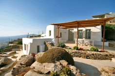Located hillside in a unique wind-sheltered position in the Fanari area, The Eagle's Nest enjoys one of the most panoramic and beautiful views of Mykonos. It overlooks the Aegean archipelago including the island of Tinos, Architecture Life, Mediterranean Architecture, Beautiful Villas, Beautiful Places, Adobe House, Mykonos Greece, Mykonos Villas, Loft, Holiday Accommodation