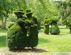 flower beds, topiary art and garden paths