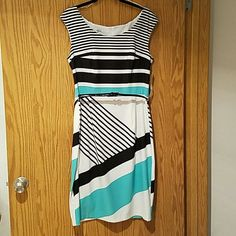 NWT Maggie London black/white/teal dress sz 12 NWT Maggie London dress. Flattering fit with removable patent leather belt. Zip back. Shell is poly/spandex and lining is 100%polyester. Dry clean only. Purchase from Nordstrom. Maggie london Dresses