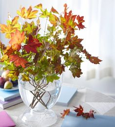 Re-create this autumnal arrangement with leaves from your own backyard! More fall decorating projects: Arrangement Fall Table Centerpieces, Centerpiece Ideas, Fall Table Settings, Autumn Table, Autumn Decorating, Decorating Ideas, Thanksgiving Decorations, Thanksgiving Table, Autumn Home