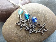 Star charm necklace with sparkly blue crystals. This pendant necklace has 3 star charms, together with 3 Czech fire polished crystal beads