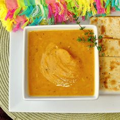 The Best Roasted Pumpkin Soup - the best pumpkin soup I have ever tried with the added natural sweetness of seasonal root vegetables and roasted garlic. Makes terrific Fall appetizer course or an amazing vegetarian lunch.