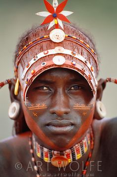 Samburu moran (warrior) with ilmasi wala hairstyle, Kenya by Art Wolfe
