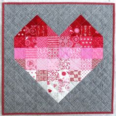 Patchwork Heart quilt, {Berry Barn Designs}.  Free pattern by Pink Door Fabrics. http://www.pinkdoorfabrics.com/products/pink-door-fabrics-mini-valentines-quilt-pattern