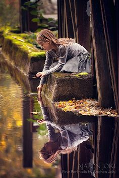 She may be the mirror of my dreams  A smile reflected in the stream  She may not be what she may seem  Inside her shell
