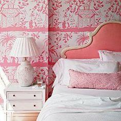 Beautiful pink wallpaper in a bedroom.