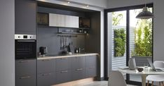 Gain more living space with a kitchen extension. To get started, explore our guide, full of kitchen extension ideas, advice and kitchen-diner photos. High Gloss Kitchen Cabinets, Glossy Kitchen, Kitchen Units, Open Plan Kitchen, New Kitchen, Kitchen Dining, Timber Kitchen, Kitchen Paint, Kitchen Flooring
