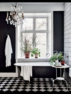 Black walls: it seems like people either love them or hate them. A black walled interior is certainly a bold design choice and not for everyone. Black walls command attention in the most dramatic of ways. They absorb a lot of natural light, so beRead Black White Bathrooms, White Rooms, Bathroom Black, Master Bathroom, Bathroom Yellow, Bathroom Vintage, Black Bathtub, Black Tub, Paint Bathroom
