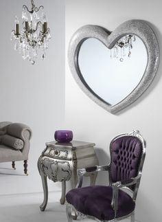 A romantic large mirror that is perfect for the bedroom or dressing room This gorgeous large heart shaped silver mirror has a frame covered in hundreds of tiny silver mosaic tiles that catch the light.