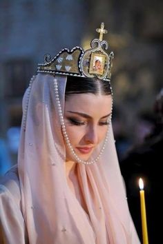An Georgian bride wearing a liturgical crown (in church, during the wedding ceremony).  Recent picture (2010s).