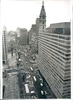 June 23, 1982: Philadelphia traffic continues to run on heavy planks which cover the construction below on the Center City Commuter Connection. The tunnel will unite regional commuter rail lines from the old Penn Central and Reading Railroad systems....
