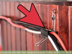 DIY:  How to Organize and Hide Computer Cables - using a screw and washer to hang a large binder clip. This is a common sense way to get wires and cables organized and out of sight - via WikiHow