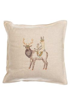 These two bunnies sit atop an elk, all are decorated for a festive adventure together.Pillow has a 95% small feather, 5% down insert.Remove cover to clean. Machine wash (inside out) with cold water using mild detergent, wash on the most gentle cycle. Do not use bleach or bleach alternative. Line dry. Iron on steam setting.    Measures 16 × 16 inches.   Embroidered Pillow Keeper by Coral & Tusk. Home & Gifts - Home Decor - Pillows & Throws Pennsylvania