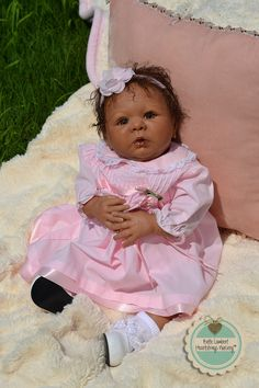 "MALAYA is a custom order baby. I created her from Denise Pratt's ""Kinsey"" sculpt. She was born June 13, 2014, is 20"" long, weighs 5 lbs. 2 oz. and lives in IOWA, USA. See her at www.heartstringsnursery.com."