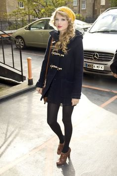 taylor swift wears a cute coat and oxford heels