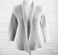 "Courie In is Scottish for ""snuggle up,"" and this oversized wrap-front cardigan is perfect for doing just that.  Choose from Cloudborn Superwash Merino Bulky yarn in Solid colors or Splash!"