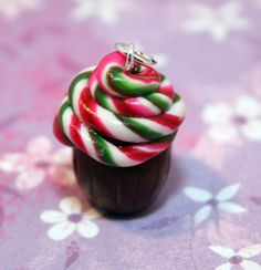 polymer clay cupcake with peppermint twist candy stick frosting...cute :)