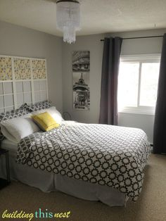 Grey and Yellow Bedroom. Window frames and grey bedding