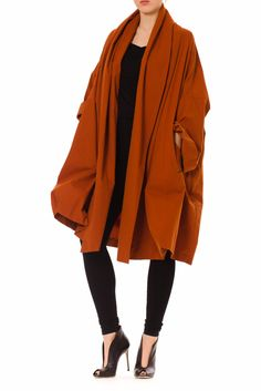 - Product Description - Measurements DETAILS Famed Italian designer Romeo Gigli designed this luxurious cape in the 80s. It is made of a provocative orange cotton blend fabrication in Italy. Its full