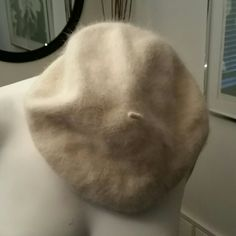 Arden B brand beret style hat. One size Arden B brand beret style hat one size angora/ nylon mix. Has cute little string tie at top. Wear to the side or you can pull down and cover your ears. Matches with EVERYTHING! Never been worn. Arden B Accessories Hats