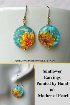 Sunflower earrings painted by hand on mother of pearl, sunflower jewelry #sunflowerjewelry #floraljewelry #handpaintedjewelry