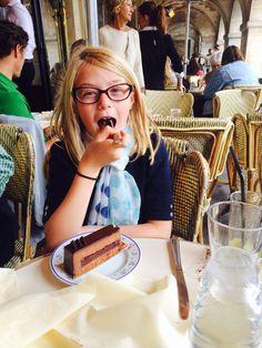 Little Ellie enjoying chocolate cake on Place des Vosges
