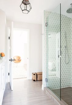 Tiles on the wall in the shower of white bathroom