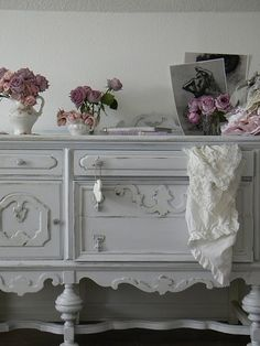 find an old dresser then sand, paint shabby white. You can find these type pieces in antiques stores all over!
