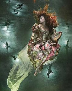 Underwater fashion photography by Zena Holloway.