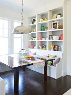 Young House Love | The Heart of The (Show) Home | http://www.younghouselove.com | banquette with shelves