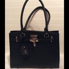"BCBG Black Padlock Tote Handbag NWT BCBG Black Handbag, Gold-Tone Hardware. 2 compartments middle zipper compartment dividing the 2 compartments. 1 inside zipper pocket, 2 inside slip pockets. Dual handles, handle drop 9"".  Studs on the bottom. 11"" x 14. NWT BCBG Bags"