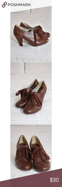 "Brown American Eagle Oxford Heels ⭐️Make an offer! Adorable brown oxfords with lots of life left! Only worn a handful of times, these vintage inspired heels are a great staple for your office wardrobe! Ribbon Laced, 3.5"" heel. Super cute! Open to reasonable offers! ⭐️ American Eagle by Payless Shoes Heels"