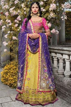 Indian mehndi dress in yellow and pink color with purple dupatta. Lehnga style Indian mehndi dress embroidered with threads, pearls, dabka and sitara Bridal Dupatta, Bridal Mehndi Dresses, Bridal Dresses Online, Bridal Outfits, Wedding Mehndi, Pakistani Mehndi Dress, Pakistani Bridal Wear, Pakistani Dresses, Yellow Lehenga