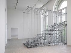 Monica Bonvicini SCALE OF THINGS (to come) - 2010 scaffolding metal pipes, galvanized plates and chains, clamps 393 x 192 x 485 cm