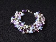 """A Bracelet inspired by DeBussys """"Jardins sous la pluie"""" (""""Gardens in the Rain"""") by K for 'Trifles & Whimsy' on Etsy. Amethyst, Garnets, Freshwater Pearls, and Swarovski Crystals"""