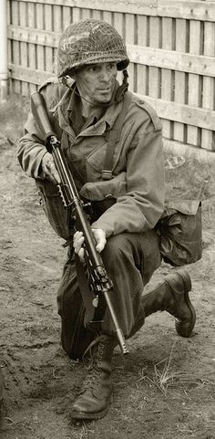 Looks to me like he grabbed a bit of German weaponry there. That German Weaponry is the German STG44 or MP 44. Was the first Assault Rifle in History. Had the ability to shot a round that was a mixture of a bolt action rifle and an smg.