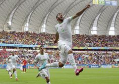 Algeria's Rafik Halliche (5) celebrates after scoring his side's second goal during the group H World Cup soccer match between South Korea a...