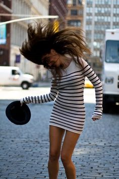 Black & White stripped sweater dress Really cute dress and haha I bet the model had fun in this shoot...obviously (The hair) :)